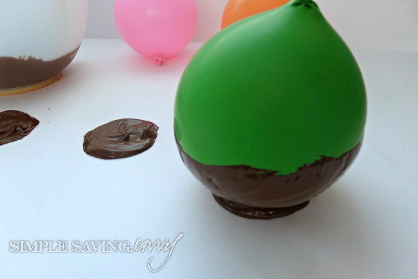 Place chocolate covered balloon on parchment paper