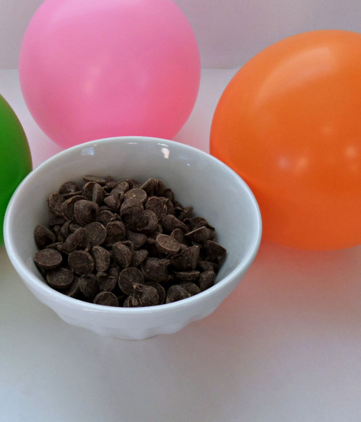 Blow up balloons to desired size of chocolate dessert bowls