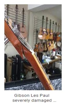Damaged Gibson Les Paul guitar