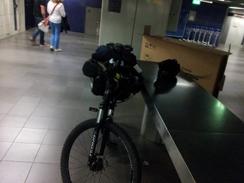 Stewart Innes Ghost Bike in Schipol Airport Amsterdam being packed for transit to UK