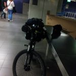 Ghost Bike in Schipol Airport Amsterdam being packed for transit to UK
