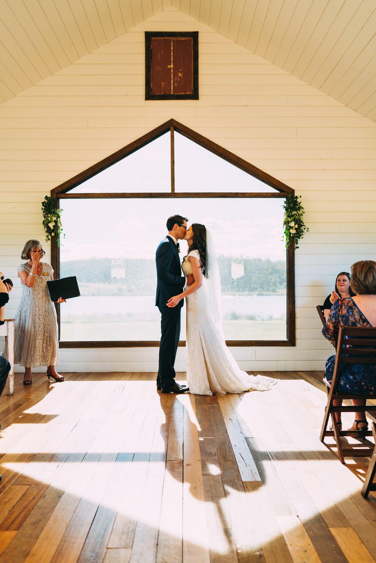 bride groom kissing