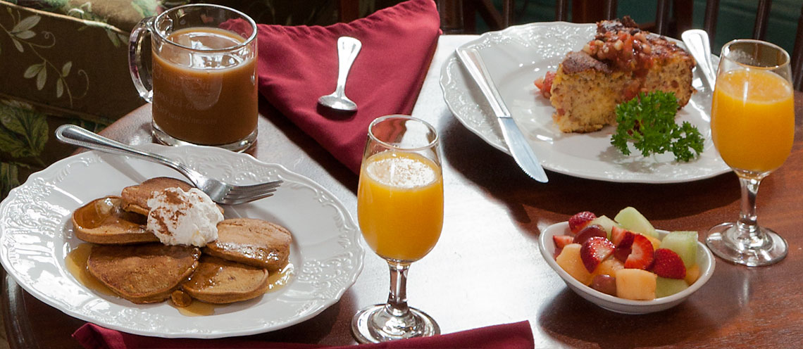 breakfast plates of pancakes and quiche