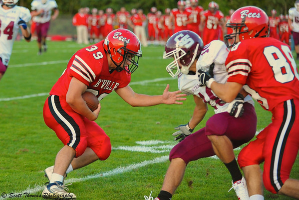 Baldwinsville Bees fullback Jim Lang (29) cuts down field against the Central Square Redhawks.
