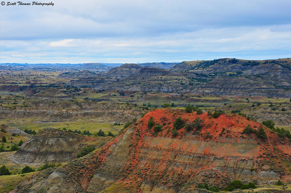The Painted Canyon in Theodore Roosevelt National Park under an overcast sky.