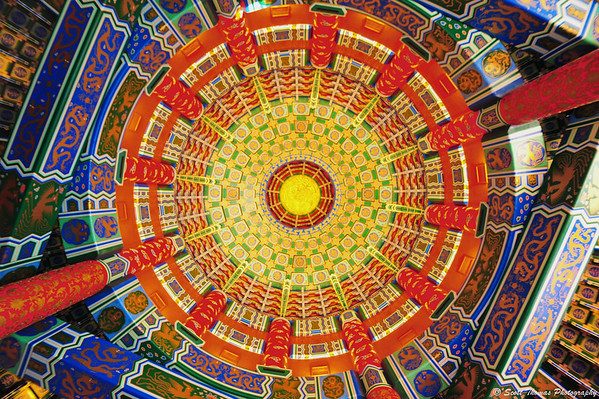 The ornate and colorful ceiling inside the Hall of Prayer for Good Harvest in Epcot's China pavilion.