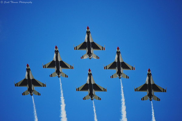 The Thunderbirds' F-16 fighter jets in tight formation photographed from below as they completed their flyover of the Magic Kingdom.