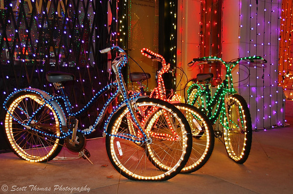 Lighted bicycles at the Osborne Family Spectacle of Dancing Lights on the Streets of America city backlots in Disney's Hollywood Studios.