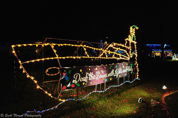 Deck the Bowes with Lights and Holly.  A cruiser light display across from the marina on the Lights on the Lake path.