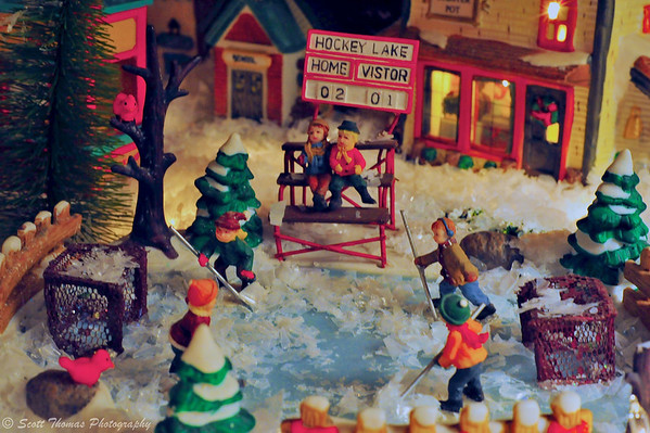 The home features a large holiday miniature village with a hockey game going on.