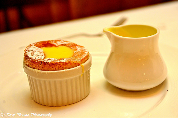 Grand Marnier Souffle infused with fresh orange zest and served with creme Anglaise in the Royal Palace restaurant of the Disney Dream.