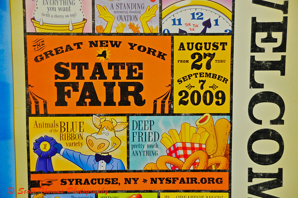The poster for this years Great New York State Fair is whimsical.  As an aside, this years big fried food craze is Deep Fried Peanut Butter and Jelly.  Yum-yum!