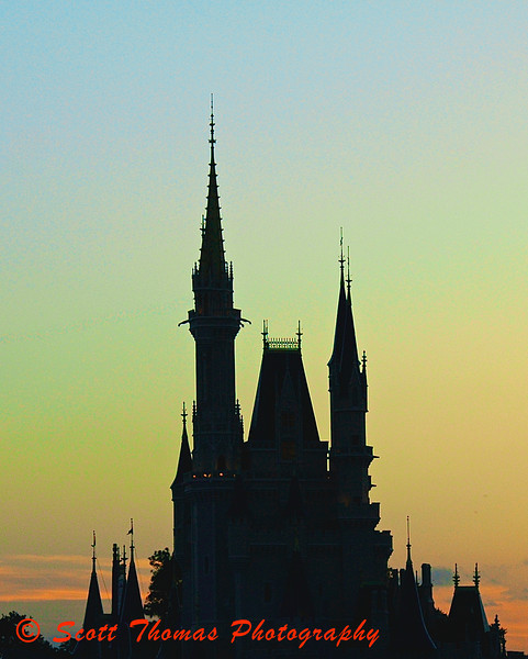 Castle at Dusk.  Cinderella Castle taken from the Tomorrowland Transportation Authority in the Magic Kingdom, Walt Disney World, Orlando, Florida.