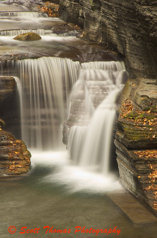 Many smaller and a couple of larger waterfalls are Natures tools of change in the four mile long gorge through the Robert H. Treman State Park near Ithaca, New York.