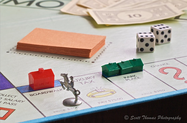 Prime Real Estate.  The player with the horse and rider token owes the owner of Boardwalk with a Hotel a total of $2000 in rent.