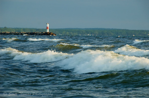 Lake Ontario waves hit the Port Ontario break wall.