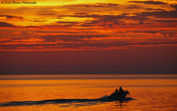 A boat going on an evening cruise on Lake Ontario at sunset.