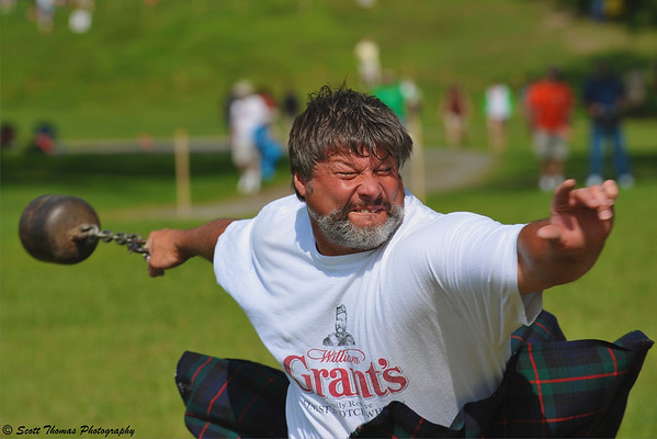 Craig Northrup of Rochester, N.Y. competes in the 56 pound Stone Throwing event at the CNY Scottish Games at Long Branch Park in Liverpool, New York, on Saturday, August 14, 2010.
