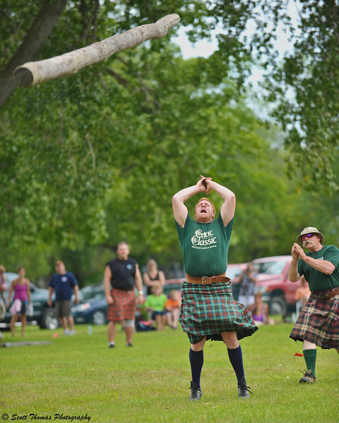Will Barron of Syracuse, N. Y. competes in the Caber Toss at the CNY Scottish Games at Long Branch Park in Liverpool, New York, on Saturday, August 14, 2010.