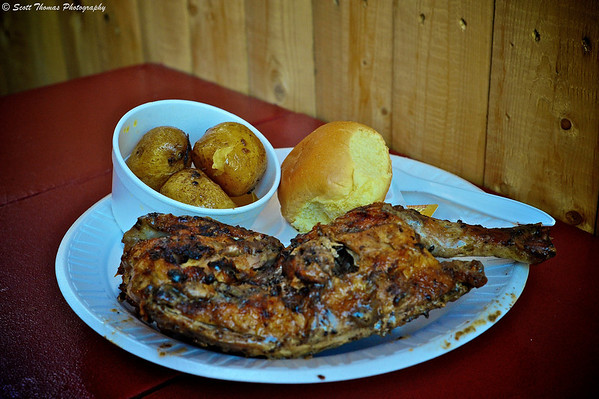 The half chicken dinner from Baker's Chicken Coop featuring salt potatoes, a roll and Baker's famous marinated BBQ'd chicken.