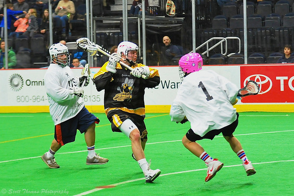Syracuse Stingers Dave Wood (3) splits the NYC Lax All-Stars defense at the Onondaga County War Memorial in Syracuse, New York on Thursday, February 21, 2013.