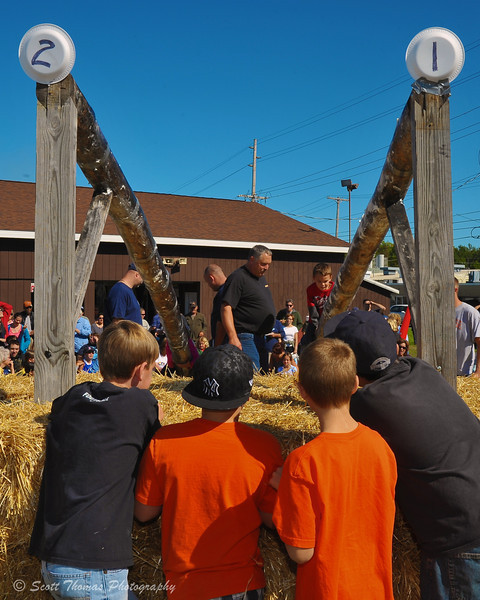 Contestants wait for their turn at the Kid's Greased Pole Cross at the Jordan Fall Festival in Jordan, New York.