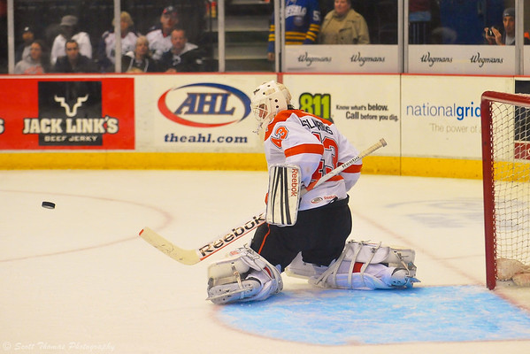 Syracuse Crunch goalie Jeff Deslauriers (43) kicks out a shot against the Adirondack Phantoms.