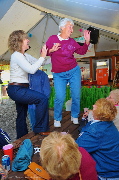 My Aunt dancing on the table for her 80th Birthday in the Tiki Tent at Hazlitt Vineyards on Seneca Lake in the Finger Lakes region of New York.