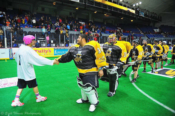 Syracuse Stingers goalie Spencer Lyons (34) leads his team in shaking hands with their opponent the NYC Lax All-Stars at the Onondaga County War Memorial in Syracuse, New York on Thursday, February 21, 2013. Stingers won the game, 19-8.