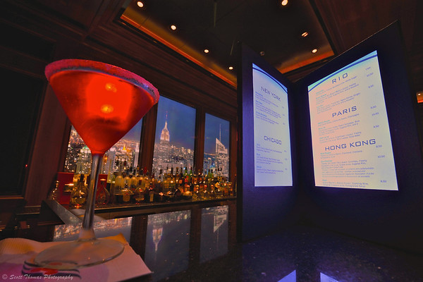 A New Yorker cocktail with glow cube sits on the bar of the Skyline night club on the Disney Dream cruise ship.