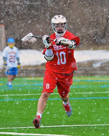 Baldwinsville Bees Eric Candee (10) looking to make a pass against the Cazenovia Lakers in a Spring snow shower on Saturday, April 5, 2015 at Cazenovia, New York.