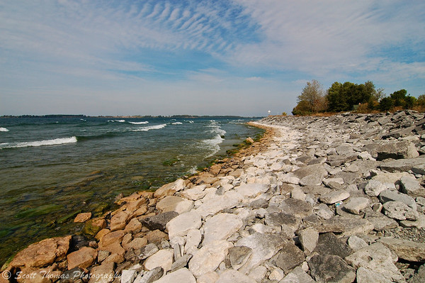 Northeastern rocky Lake Ontario shoreline at the entrance to the St. Lawrence River near Cape Vincent, New York.