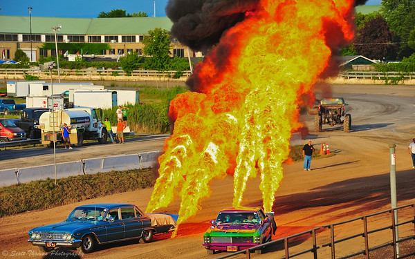 Flame throwing cars shooting flames fifty feet into the air at the Syracuse Nationals Hot Rod Show.