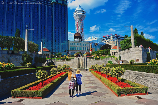Tourists stop to photograph the Casino Niagara behind Queen Victoria park at Niagara Falls in Ontario, Canada.