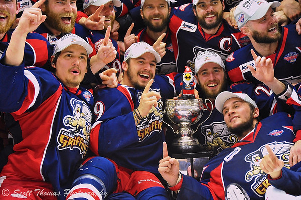 Players of the Grand Rapids Griffins celebrate winning American Hockey League's (AHL) Calder Cup championship at the Onondaga County War Memorial in Syracuse, New York on Tuesday, June 18, 2013.