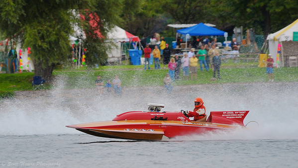 The vintage racing boat J-444 Big John's Edelweiss doing a fly-by at the HydroBowl on Seneca Lake  in Geneva, New York.