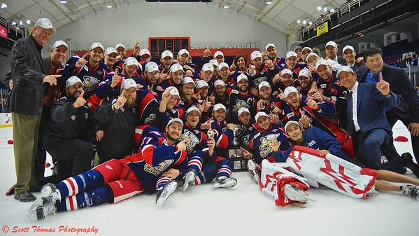 Grand Rapids Griffins players celebrate winning the American Hockey League's (AHL) Calder Cup championship at the Onondaga County War Memorial in Syracuse, New York on Tuesday, June 18, 2013.