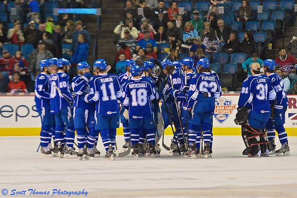 Syracuse Crunch players linger on the ice after defeating the Hamilton Bulldogs, 3-1, in American Hockey League (AHL) action at the FirstOntario Center in Hamilton, Ontario, Canada on Saturday, April 19, 2014.