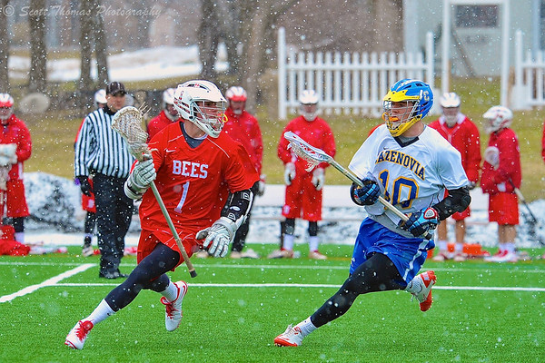 Baldwinsville Bees Mitch Rein (1) with the ball against Cazenovia Lakers PJ Brown (10) as the snow falls on Saturday, April 5, 2015 at Cazenovia, New York.