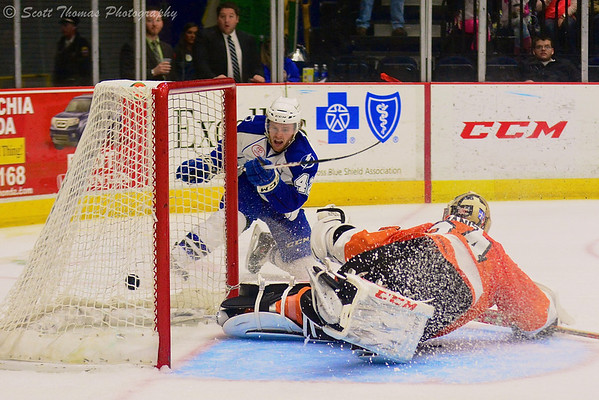 Syracuse Crunch Dana Tyrell (42) puts the puck past Adirondack Phantoms goalie Yann Danis (34) in American Hockey League (AHL) action at the War Memorial Arena on Saturday, March 1, 2014. Syracuse won in overtime, 5-4.