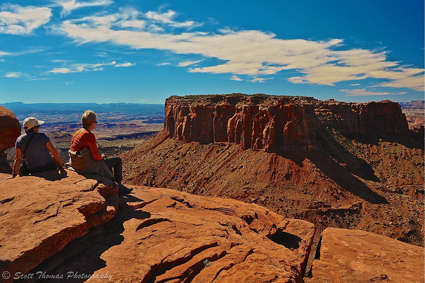 Tourists look out over Canyonlands National Park from Grand View Point near Moab, Utah.