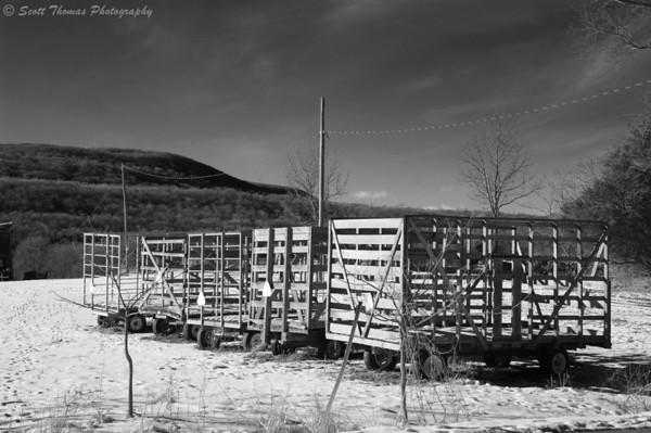 Hay wagons sitting in a snowy field near LaFayette, New York.