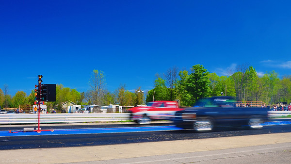Racing trucks take off during time trials at ESTA Safety Park Dragstrip near Cicero, New York