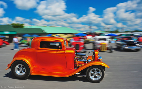 An orange coupe hot rod entering the New York State Fairgrounds for the 13th annual Syracuse Nationals Car Show.
