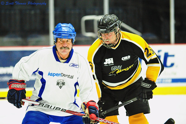 Older hockey players proving age is only a state of mind as they play in a charity game at the War Memorial in Syracuse, New York.