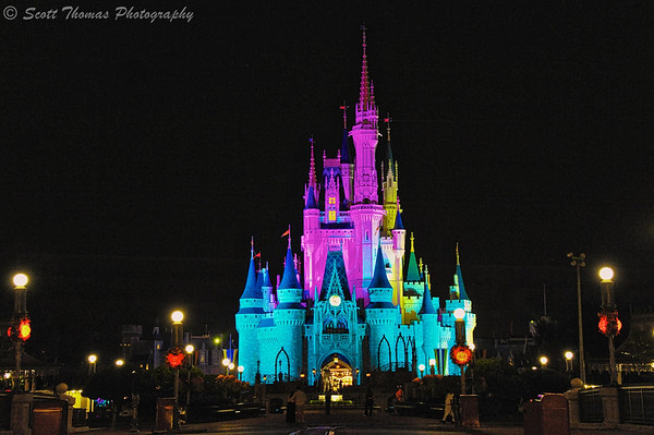 Cinderella Castle under colored lights in the Magic Kingdom close to midnight at Walt Disney World, Orlando, Florida.