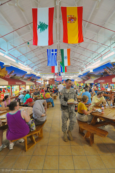 A soldier walking to a table to eat in the International building which features cuisine from all over the world at The Great New York State Fair in Syracuse, New York.