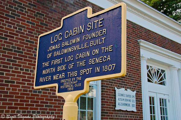 An historical marker of the log cabin site of the founder of Baldwinsville, New York, Jonas Baldwin.