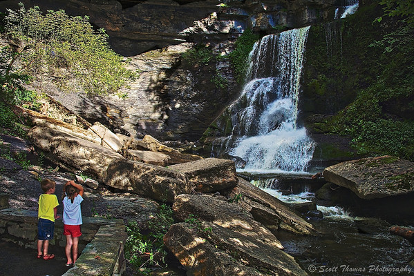 Two siblings see Cowsheds Falls in Fillmore Glen State Park near Moravia, New York for the first time.