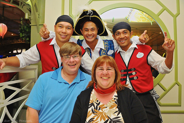 Our fantastic dining crew on the Disney Dream during Pirate Night in the Enchanted Garden restaurant.